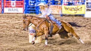 Barrel Racing Cowgirl by Mark Ruckman