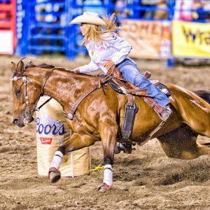 Barrel Racing Cowgirl by Mark Ruckman