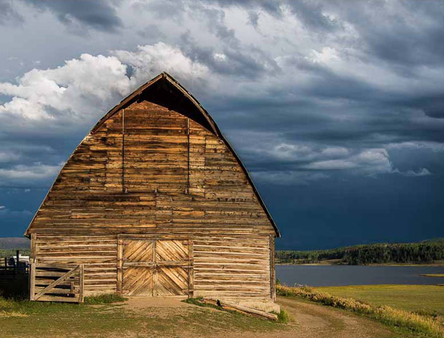 Old barn in a Stormy landscape by Mark Ruckman